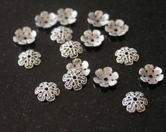 50 bead caps in antique silver. (ref:0027).