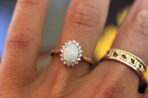 rose engagement brides oval gold grace fresh the of opal rings cut modern beautiful for halo