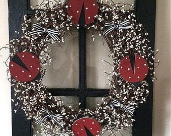 "18"" Ladybug wreath with pip berries"