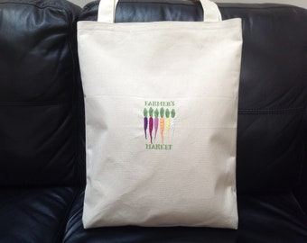 Handmade canvas shopping bag with coloured carrots on the front