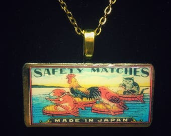 Chinese rooster cat dog and bird in  boats  - Domino pendant necklace - classic vintage matchbox label