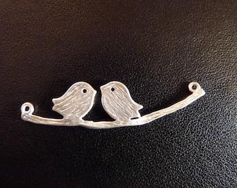 Bird on a silver branch connector