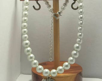 Graduated glass pearl necklace with silver plated elephant charm