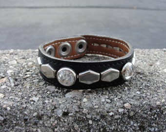 "Lined and stitched Black Leather Wristband With Genuine Swarovski Crystal 3/4"" ( 19 mm ) wide band With Hex Studs with a snap closure"