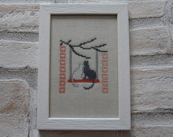 Frame embroidered cats