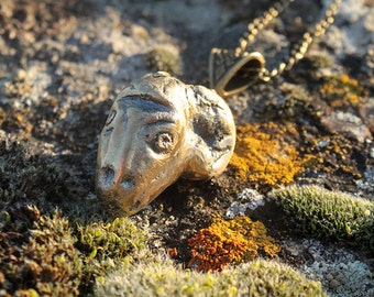 Aries cast brass pendant