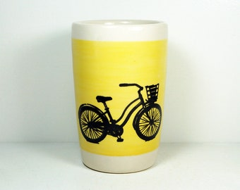 "18oz tumbler with what we like to call the ""speedy delivery"" bike on a wide band of Lemon Butter Yellow, READY TO SHIP"