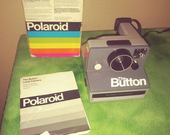 1980s Poloroid The Button Camera with box and users manual excellent condition