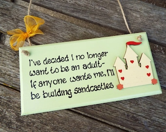 "I'VE DECIDED I no longer want to be an adult - If anyone wants me, I'll be building sandcastles [8""x4"" wooden wall plaque]"