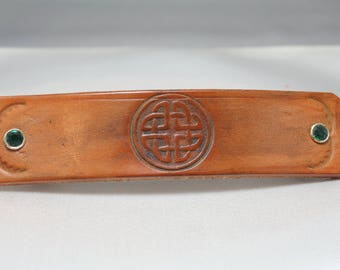 Leather barrette stamped with a Celtic design.