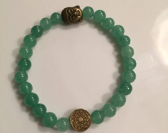 Green bracelet with bronze accents