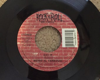 """Weird Al Yankovic's 45rpm vinyl record featuring the songs """"Eat It"""" and """"That Boy Could Dance"""""""