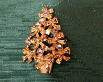 Holiday festive Avon signed Christmas tree