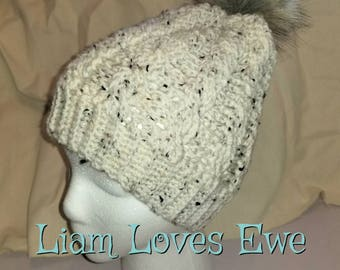 Cabled Slouch hat for teen/adult. Cream with black and light brown speckles. Pompom slouch. Pompom is cream/brown/black. 2 sizes Available.