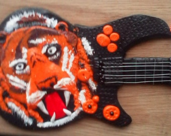 handmade tiger2 in polymer clay on oak veneer plaque guitar shape