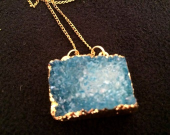 Double hooked blue crystalised stone pendant on gold tone chain