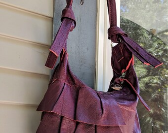 Sarah - a Burgundy Recycled Leather Messenger Bag with Ruffles, Zipper and Adjustable Strap