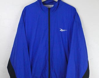 90s Vintage Reebok Windbreaker Jacket Zip Up Jacket Nylon Jacket ReebokLogo Embroidered Logo Blue Black Windbreaker Size XL