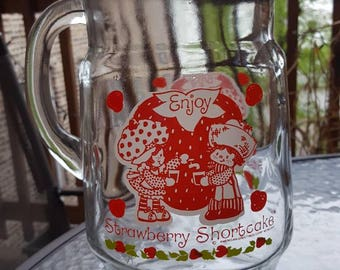 Strawberry Shortcake Vintage 1980s Collectible Pitcher featuring Huckleberry Pie. Bring nostalgia to your next party!