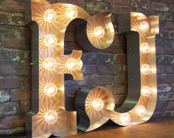Marquee light up circus font letters.