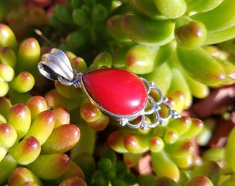 Love this Red Coral and Sterling Silver Pendant! With the scrolling under the stone it really is all in the details !