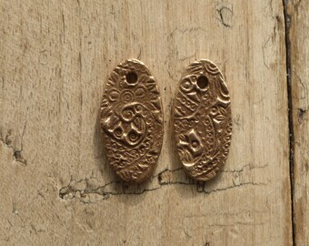 Oval bronze charms