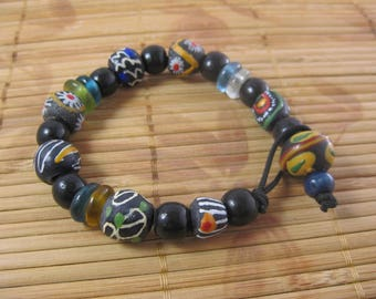King bead bracelet with African trade beads and wood  -- mainly black and colors of Africa