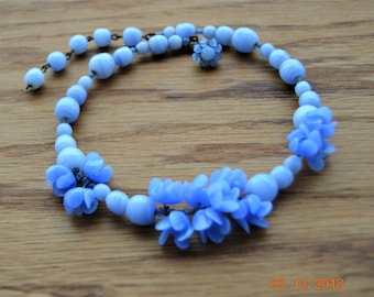 """Signed Merriam Hassel,Blue Necklace,Two Glass Flowers have one peddle broken off each,Memory  Wire Choker 14 1/2"""" long,Iconic Designer"""