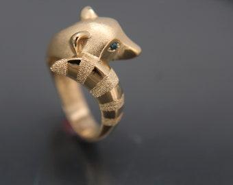 Raccoon ring,   bronze . colored stone or diamonds eyes