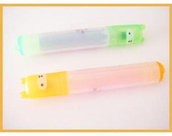 stationery - two highlighters fluorescent orange and green kawaii