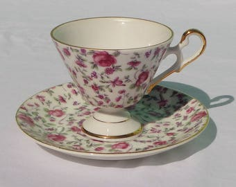vintage teacup & saucer with roses and double loop handle