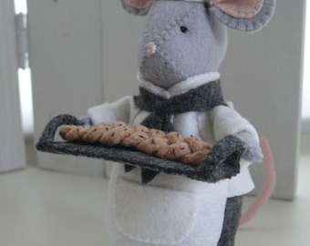 The Christmas Bakery - De Bakker. Handwerkpakket zonder de kraam.