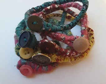 Handmade wrapped fabric and button bracelets
