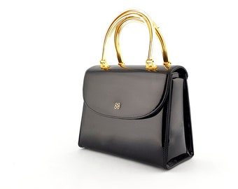 Vintage Mastercraft black patent leather handbag with gold tone double handles made in Canada