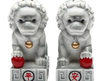 A Pair of Stone Lions with Chinese Characters Matching Salt & Pepper Shakers