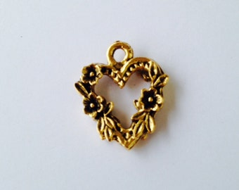 Flowered heart pewter charm in gold  finish.   Package of 12.  All of our charms are at or below wholesale prices.Made in USA.