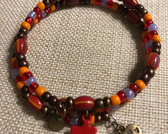 Red and Multicolored Glass Bead Bracelet with Red Puzzle Piece Charm