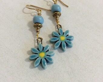 Turquoise blue daisy earrings.Kazuri ceramic daisy dangle earrings.