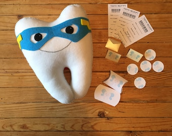 Super Tooth Fairy, made in felt, complete with extra accessories.