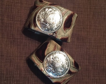 2 Brown Embossed Cowhide Napkin Rings With Bright Silver Conchos