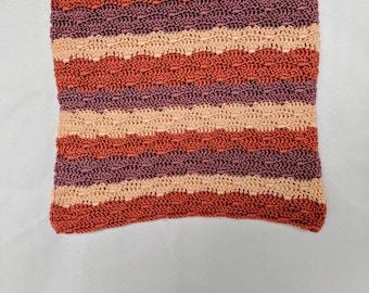 Pink crochet striped blanket