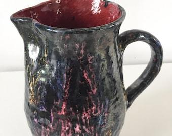 Signed enameled way stoneware jug