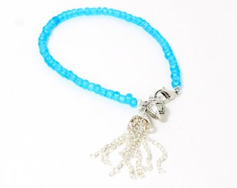 Bohemian chain tassel and ornate drop blue seed bead bracelet