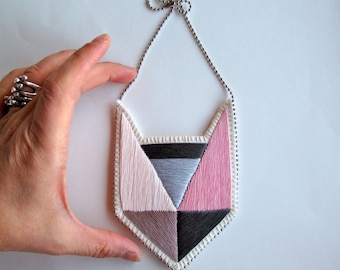 Colorblock embroidered pendant necklace with geometric design light pinks and grays with silver ball chain