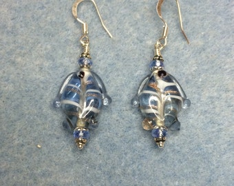 Light blue transparent lampwork fish bead dangle earrings adorned with light blue crystal beads.