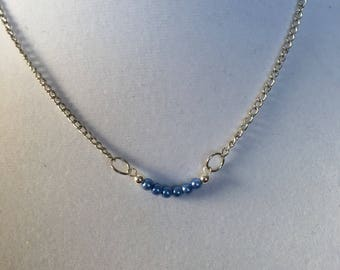 "Blue pearls on an 18"" silver chain.  Minimalist necklace."