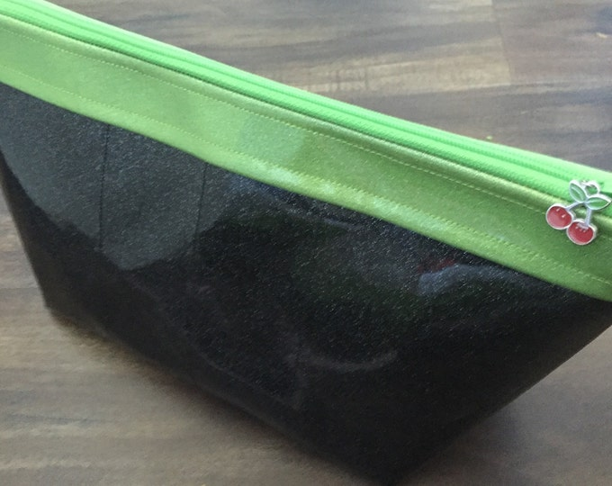 Zippered large makeup bag made of black and lime sparkle vinyl