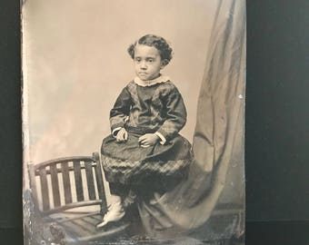 Antique tintype photograph of Charming seated African-American child