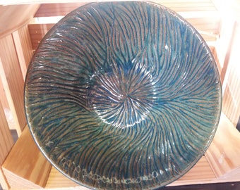 Large blue-green bowl with carvings