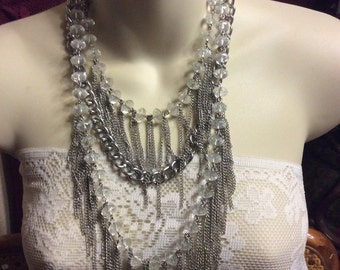 Vintage chatelaine chain dangles on faveted acrylic beads multi strand necklace .